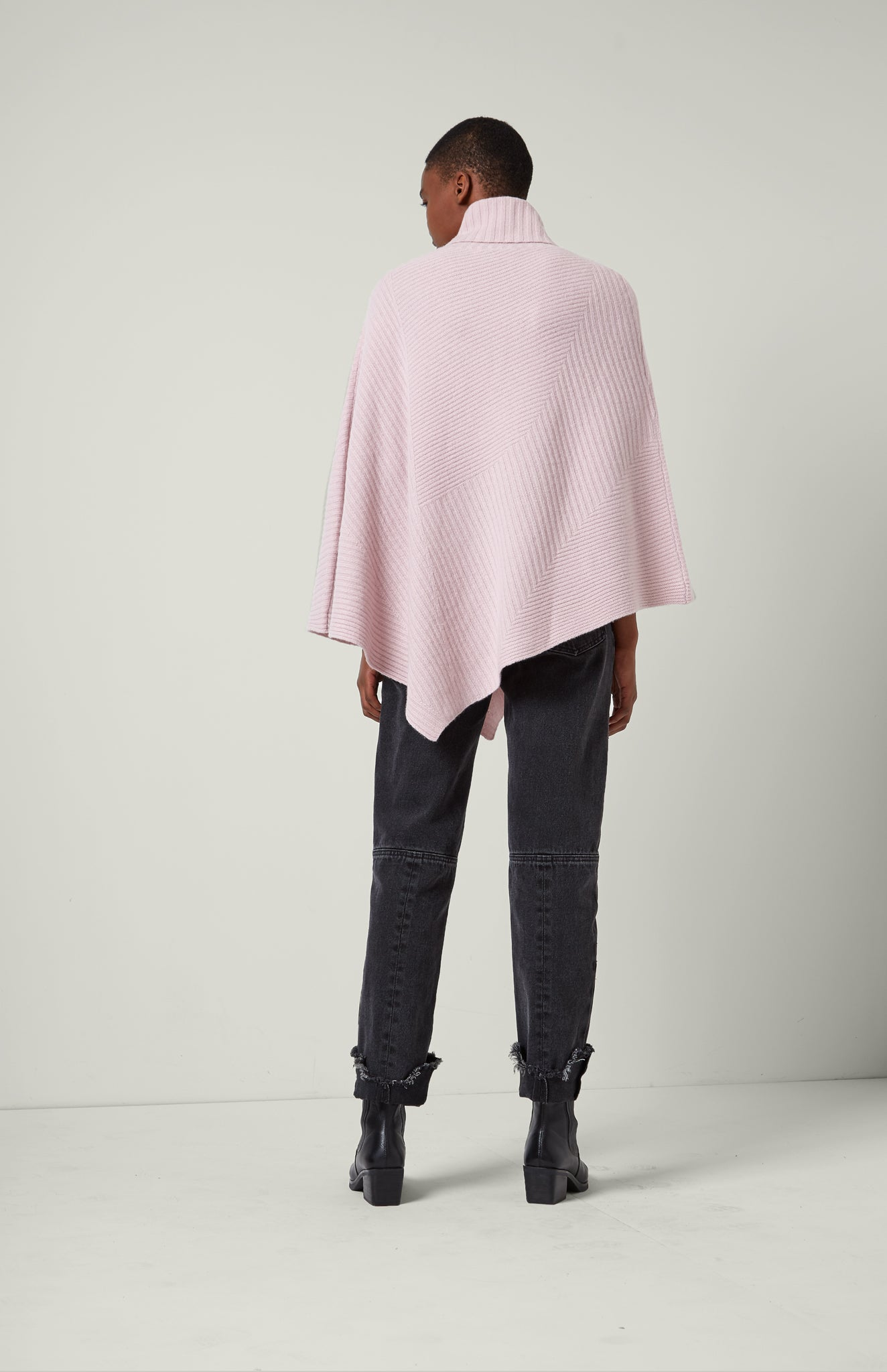 Travelling Rib Poncho In Powder Pink
