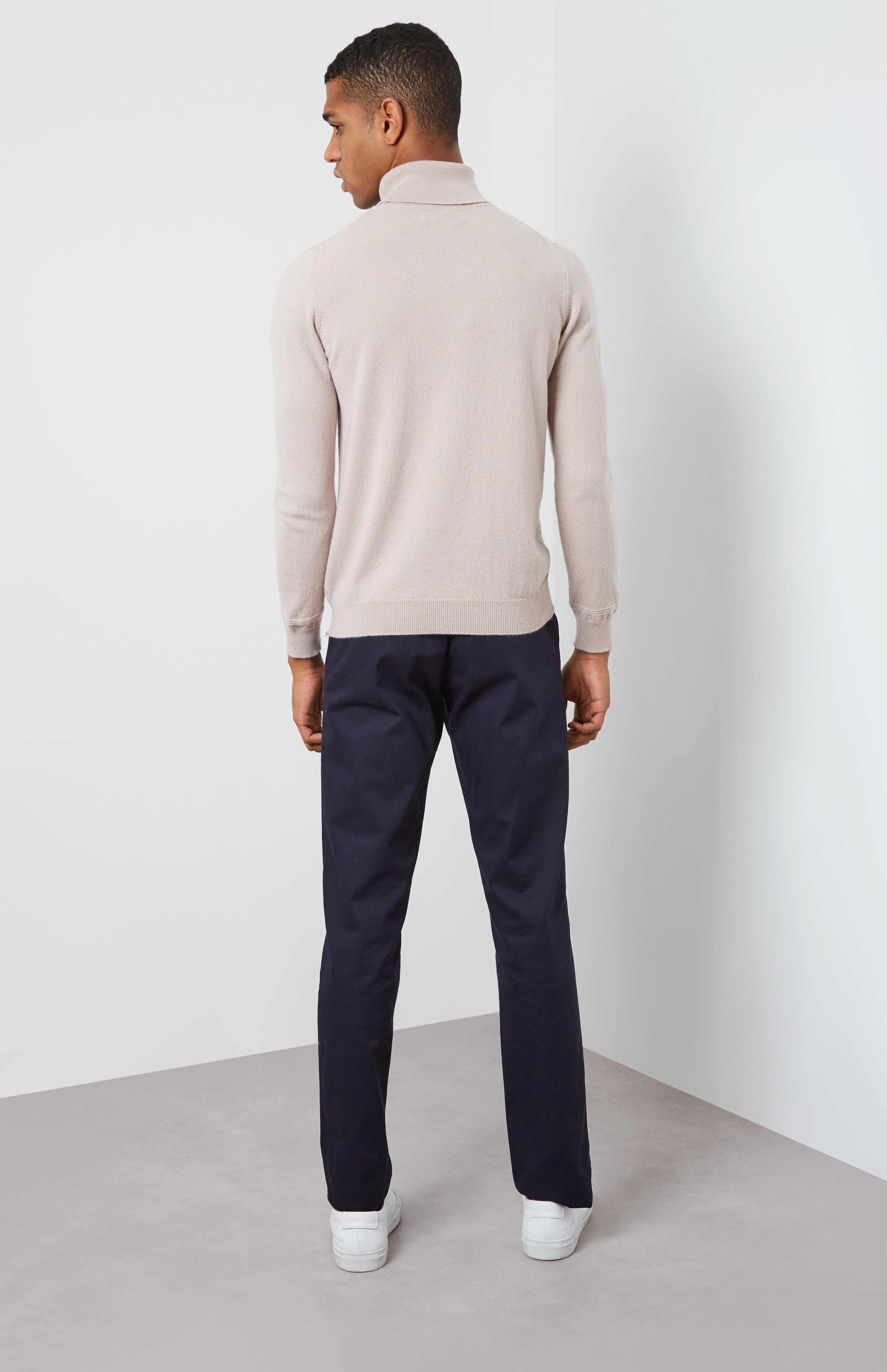 Roll Neck Cashmere Jumper In Pale Sand