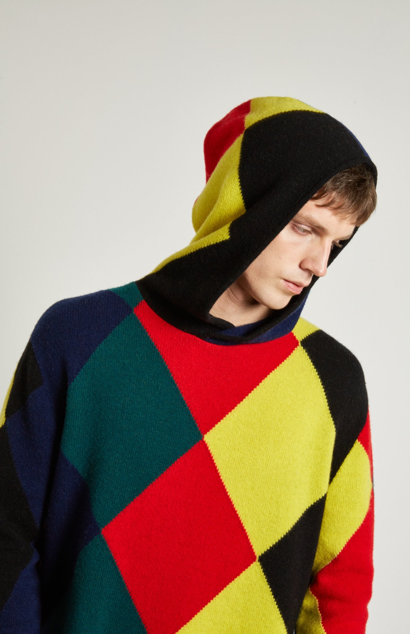 Pringle Reissued Unisex Harlequin Argyle Hoodie on male model with hood up