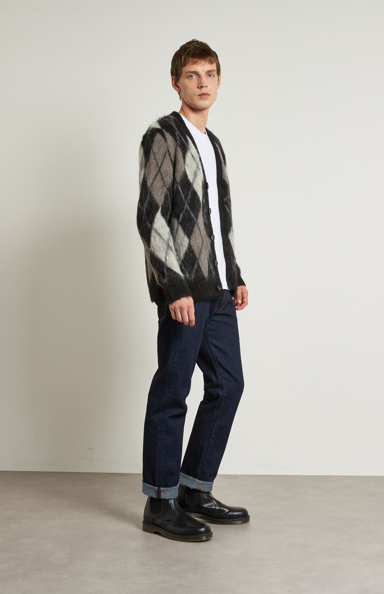Pringle Reissued Unisex Monochrome Argyle Cardigan on male model