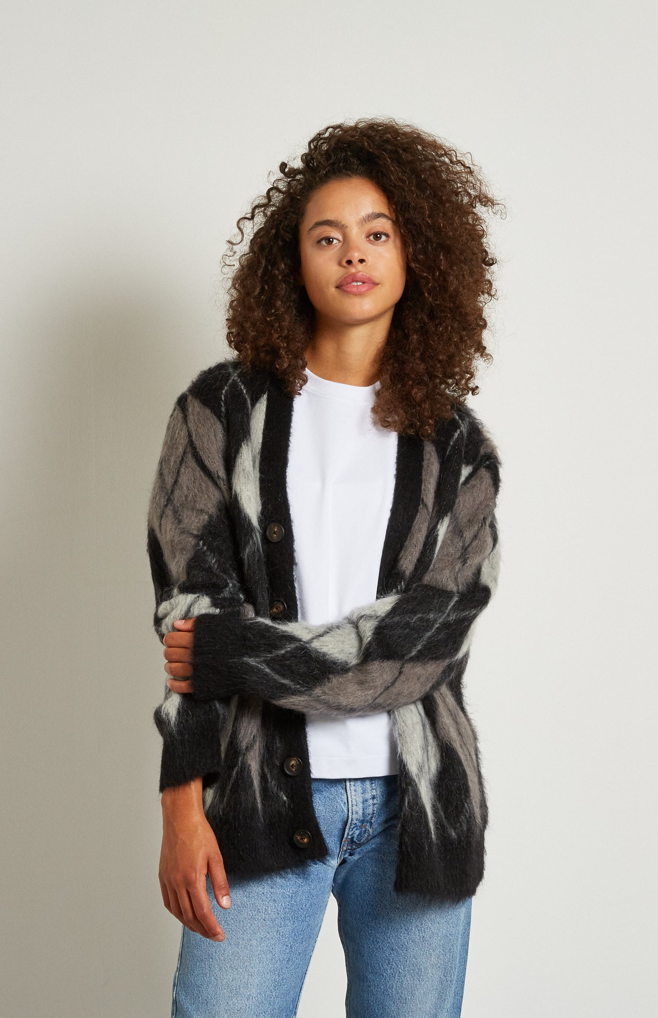 Pringle Reissued Unisex Monochrome Argyle Cardigan on female model