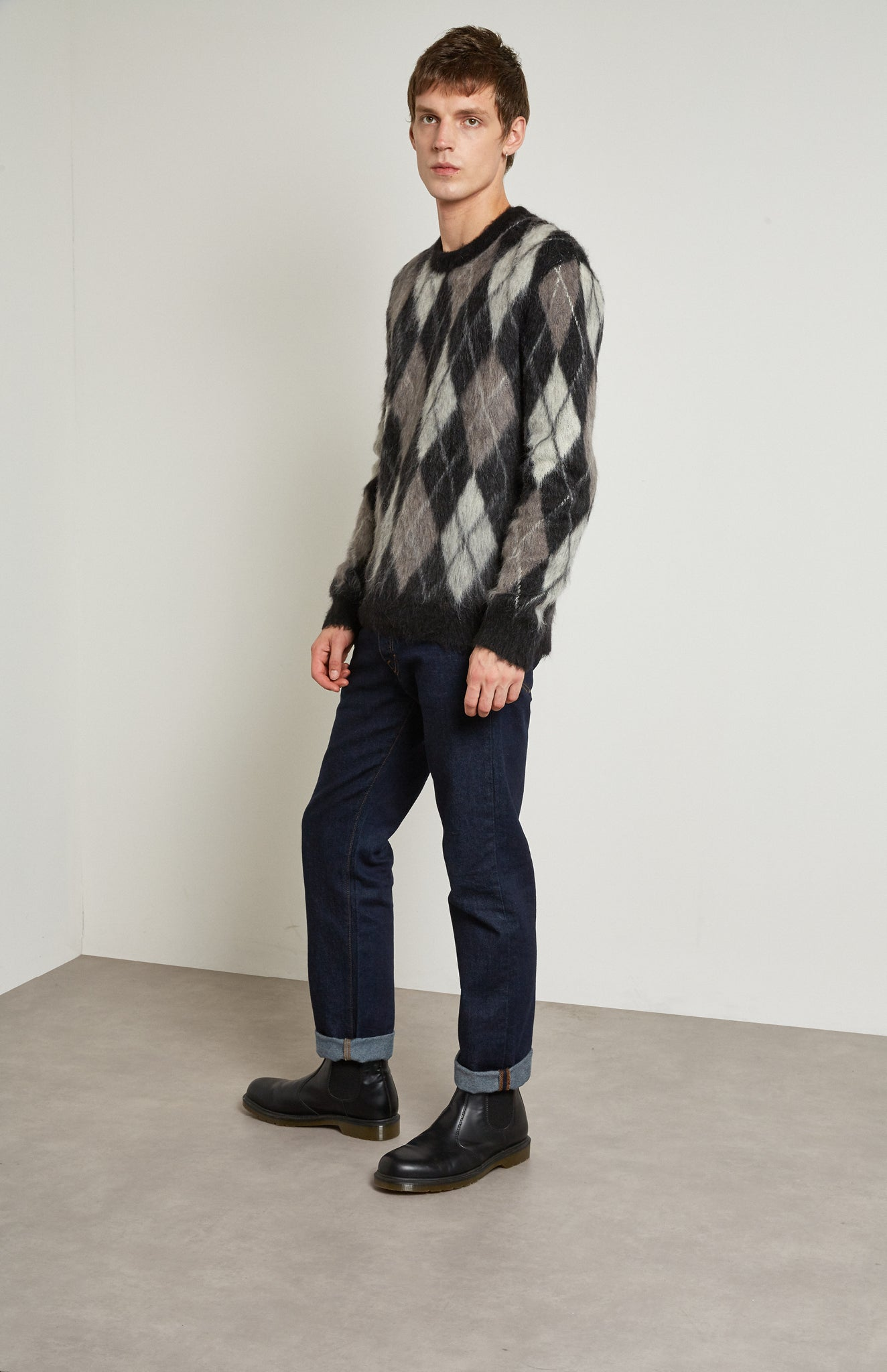Pringle Reissued Unisex Monochrome Argyle Jumper on male model