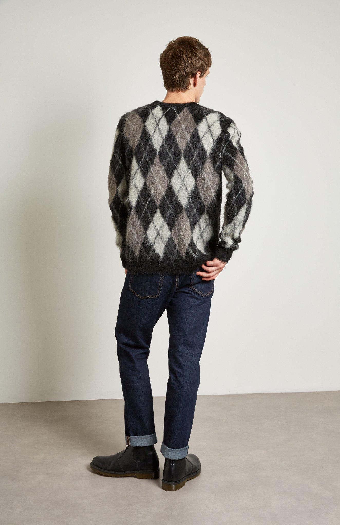 Pringle Reissued Unisex Monochrome Argyle Jumper on male model back shot