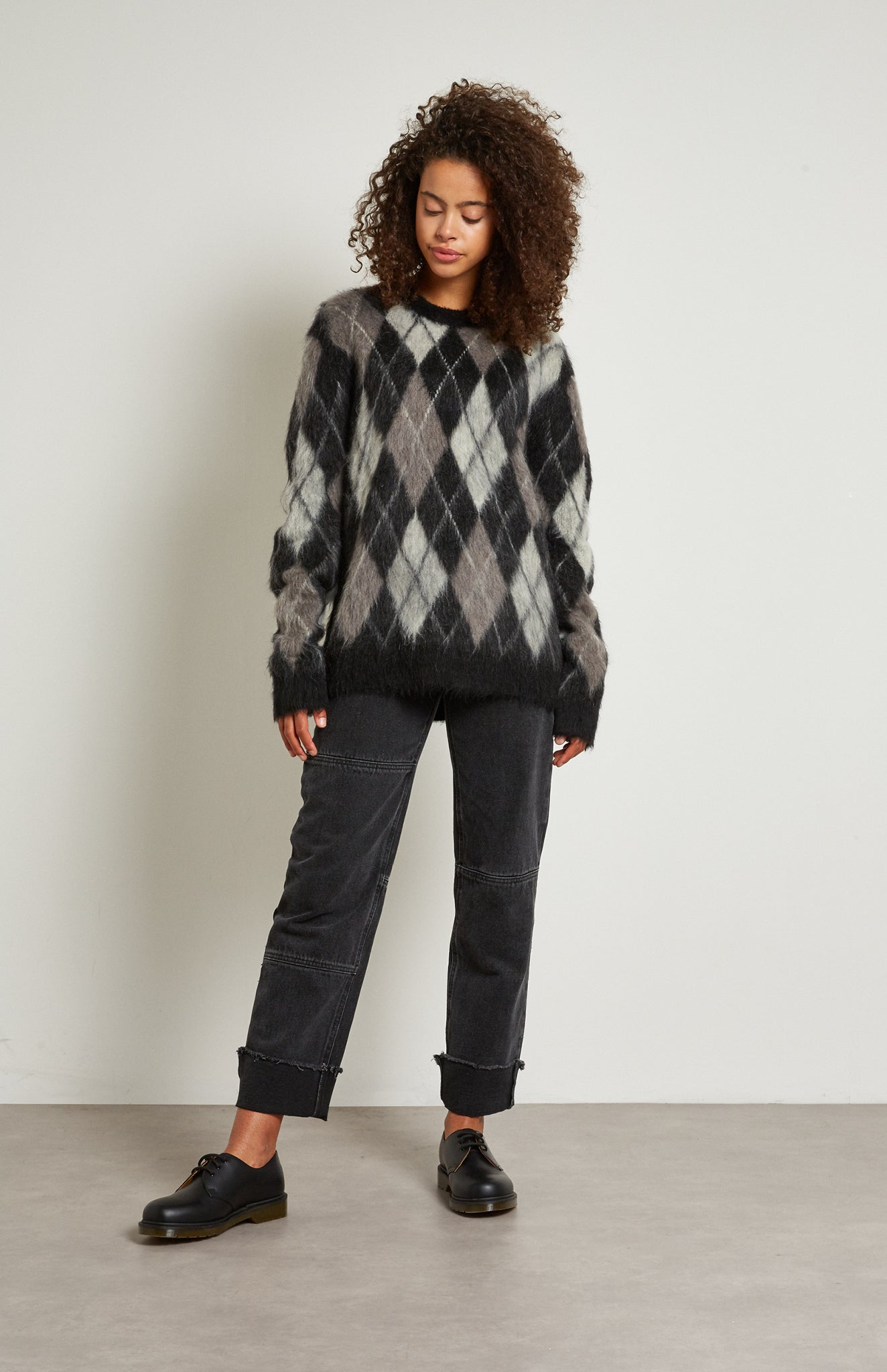 Pringle Reissued Unisex Monochrome Argyle Jumper on female model