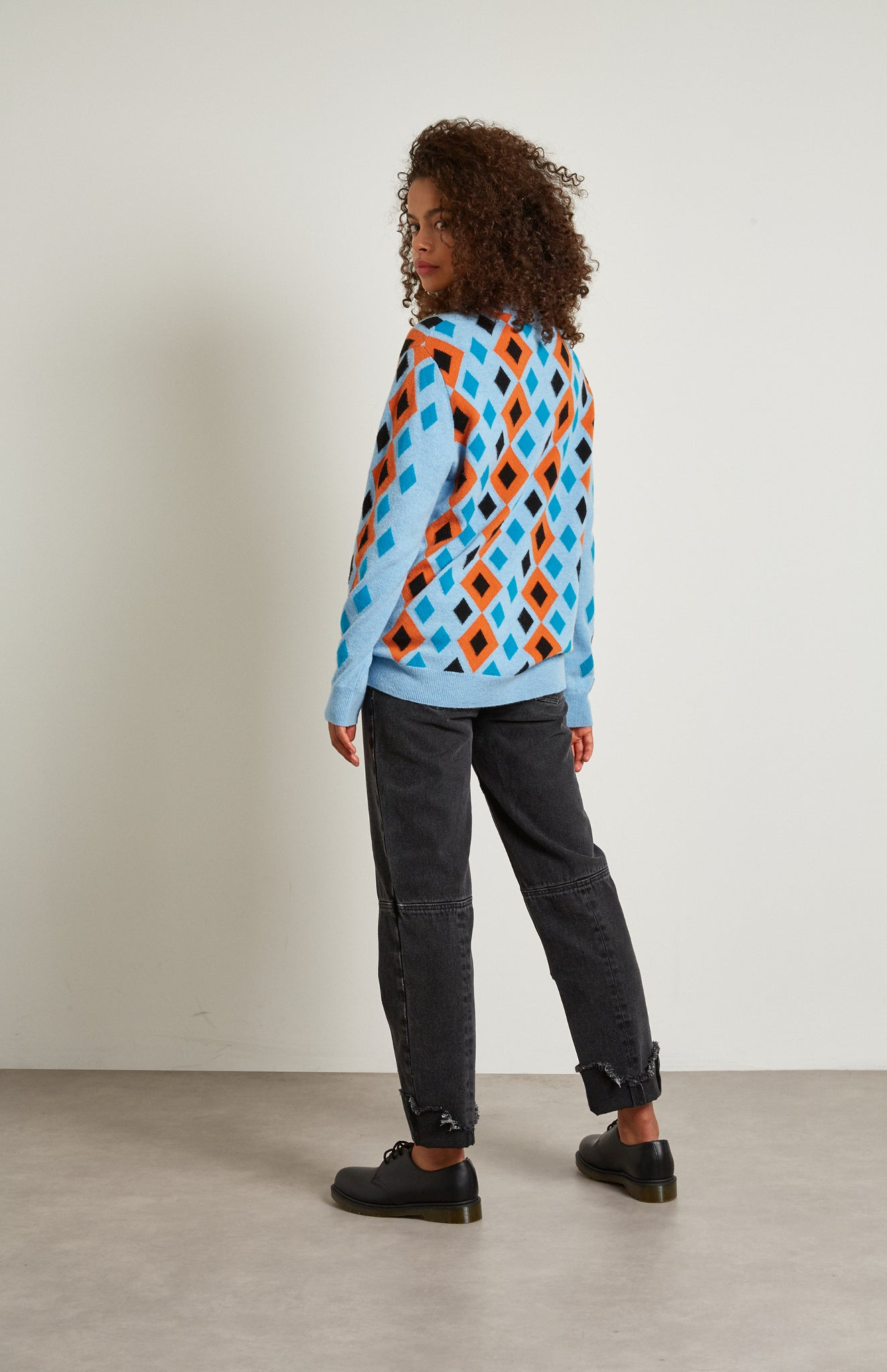 Pringle Reissued Unisex Multi Diamond Argyle Jumper In Light Blue on female model back shot