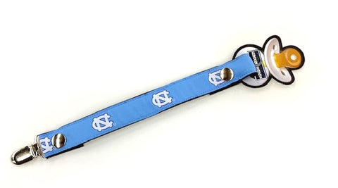 UNC Pacifier Clip in Carolina Blue with White North Carolina Logos and Snap Closure