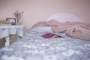 Bed with blankets and a book
