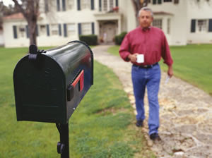 Man Getting the Mail with a Coffee