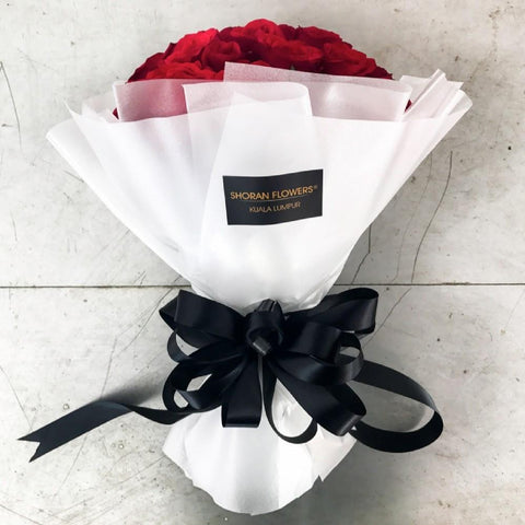 The Knockout - 60 Red Roses Bouquet