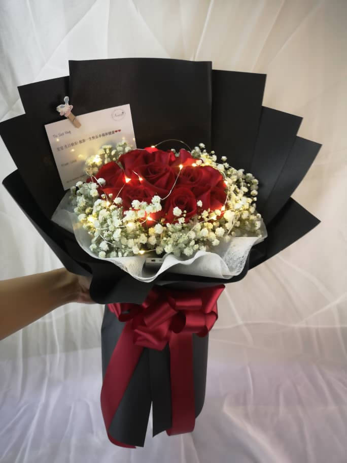 Red roses in Black with led light