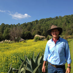 Dr. Dieter le Noir at the Sanandi Farm 2018 Rancho la Paz has yellow flowers