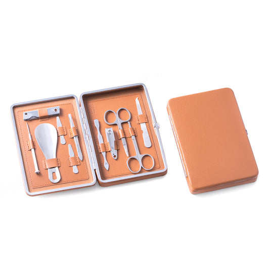 10 Pieces Manicure Set in Tan Leather Case with Small Clippers, Cuticle Cleaner, Nose & Cuticle Scissors, File, Tweezers, Collar Stays, Shoe Horn, Small Screwdriver and Multi Tool / Knife Set.
