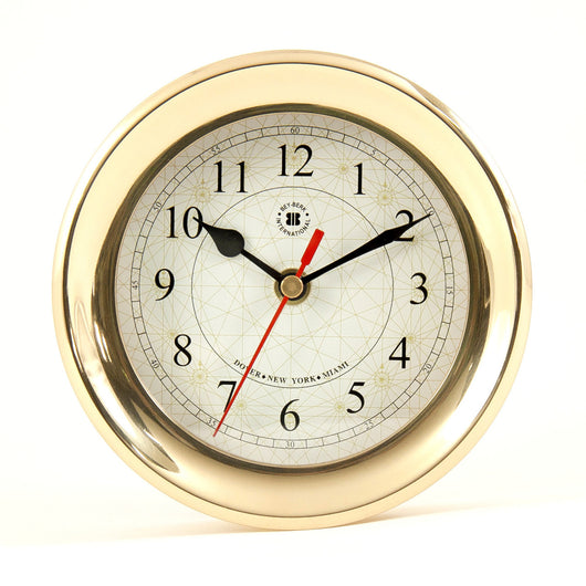 Lacquered Brass Round Quartz Clock with Beveled Glass and Compass Rose Dial Face.