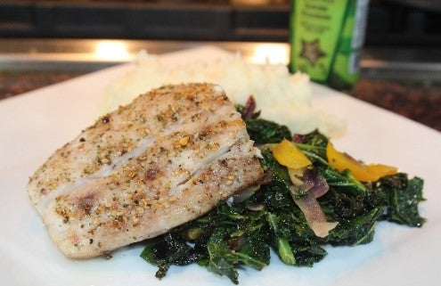Baked Mahi-Mahi on a bed of braised kale, red onions and yellow peppers