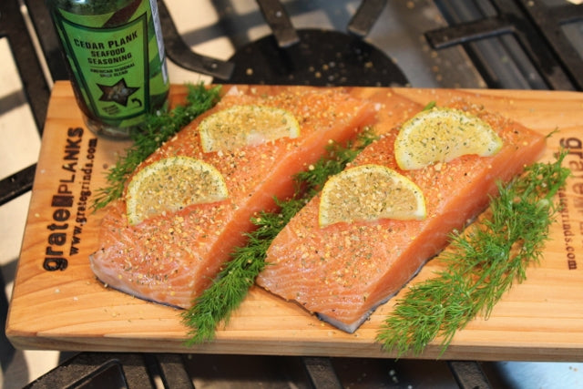 Salmon filets on cedar planks with Cedar Plank Seafood Seasoning ready for the oven or grill