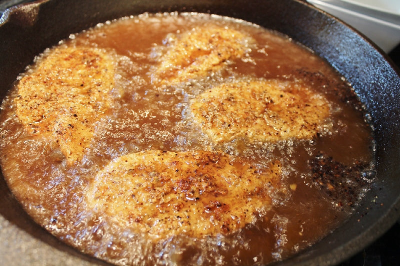 Chicken continued to fry after being turned over in the oil.