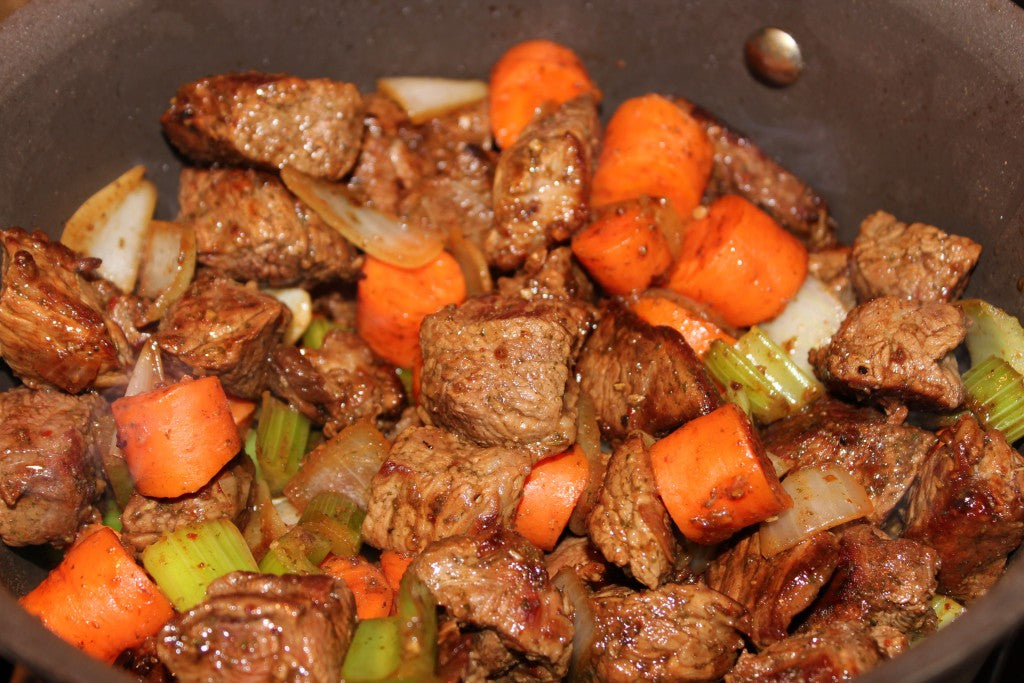 Adding the beef into the mirepoix.