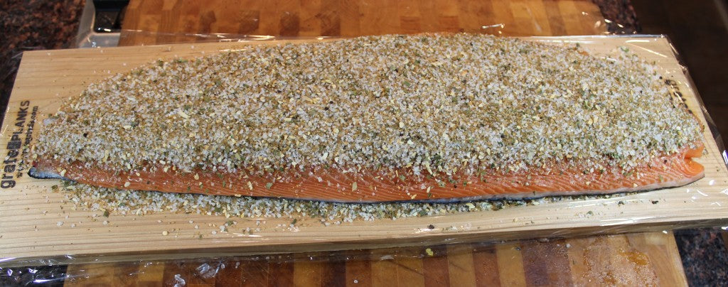 Spread the remaining salt/sugar/herb mix evenly on the salmon