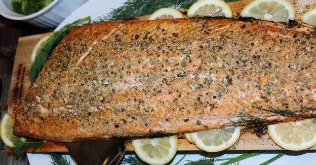 Full side of cedar plank roast salmon ready for dinner presentation.