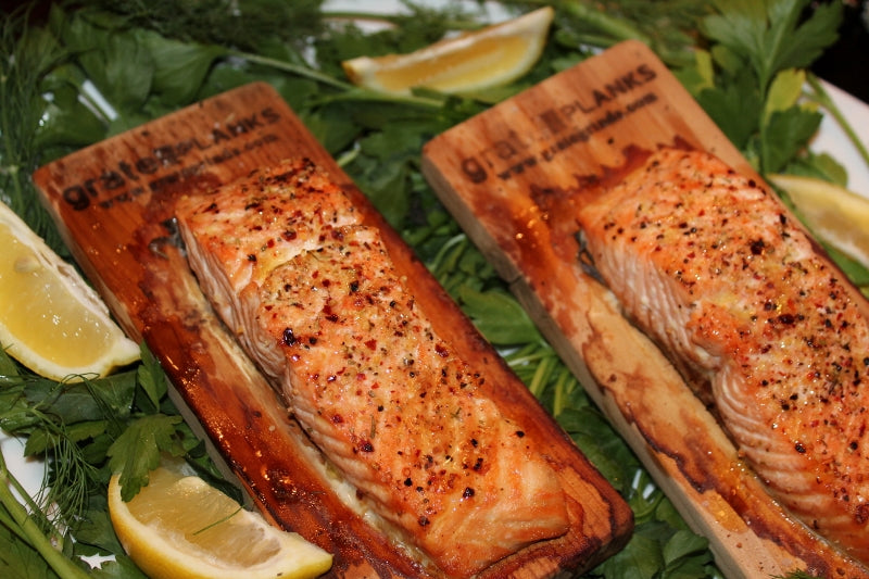 Roast salmon filets on a cedar cooking plank.