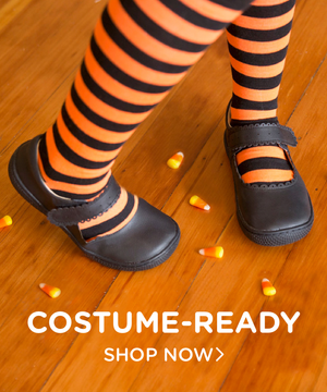 girl in halloween outfit with shoes