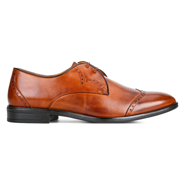 Carol: Tan wingtip Derby