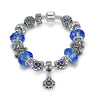 Silver Plated Charm Bracelet with Blue Glass Beads, Blue Rhinestones & Flower Pendant - DesignIN