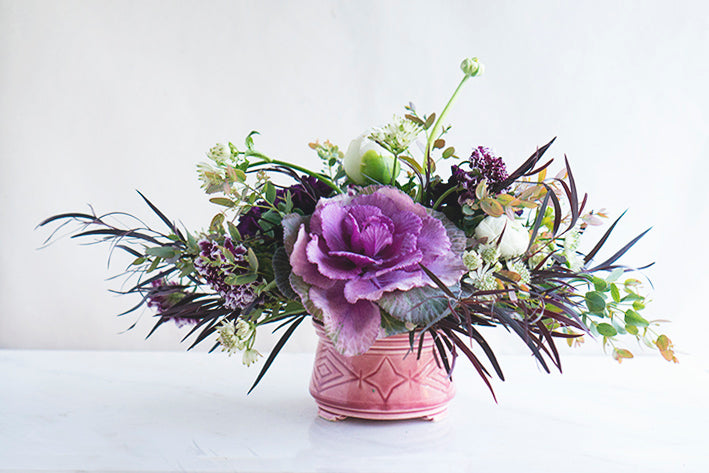 purple cabbage floral arrangement with a modern and chic styling
