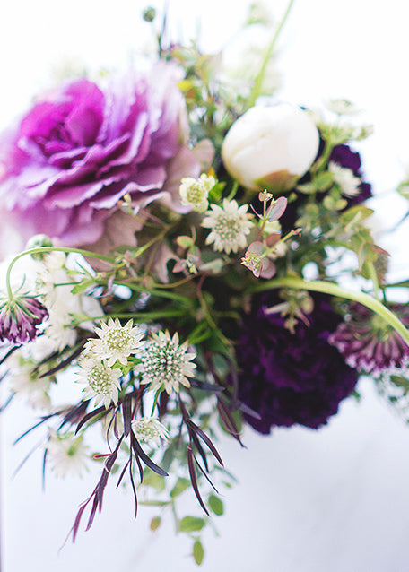 purple and white floral arrangement close up