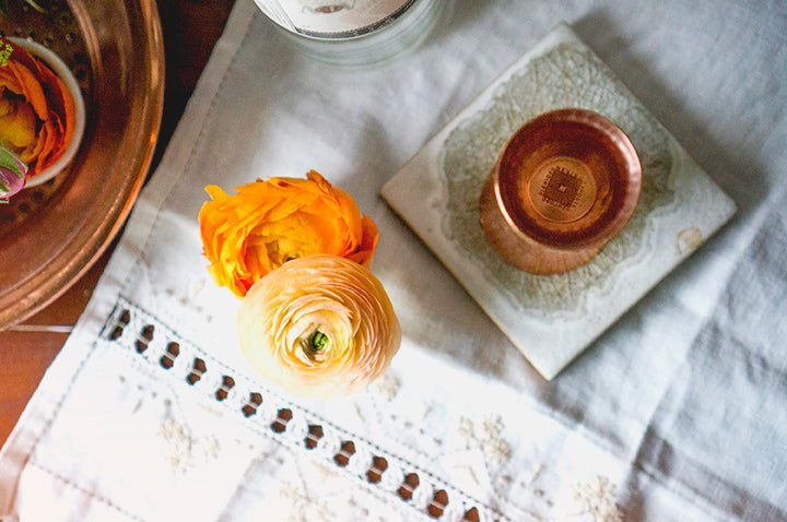 copper barware and ranunnculus