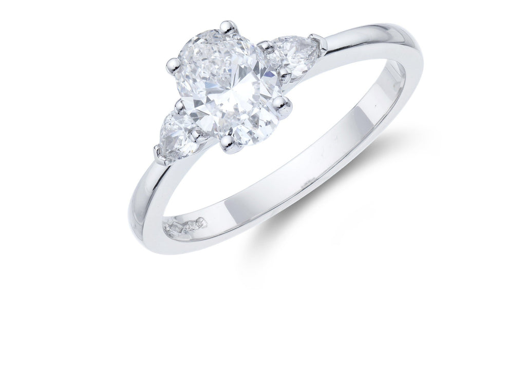 Platinum 3 Stone Oval and Pear Cut Diamond Ring