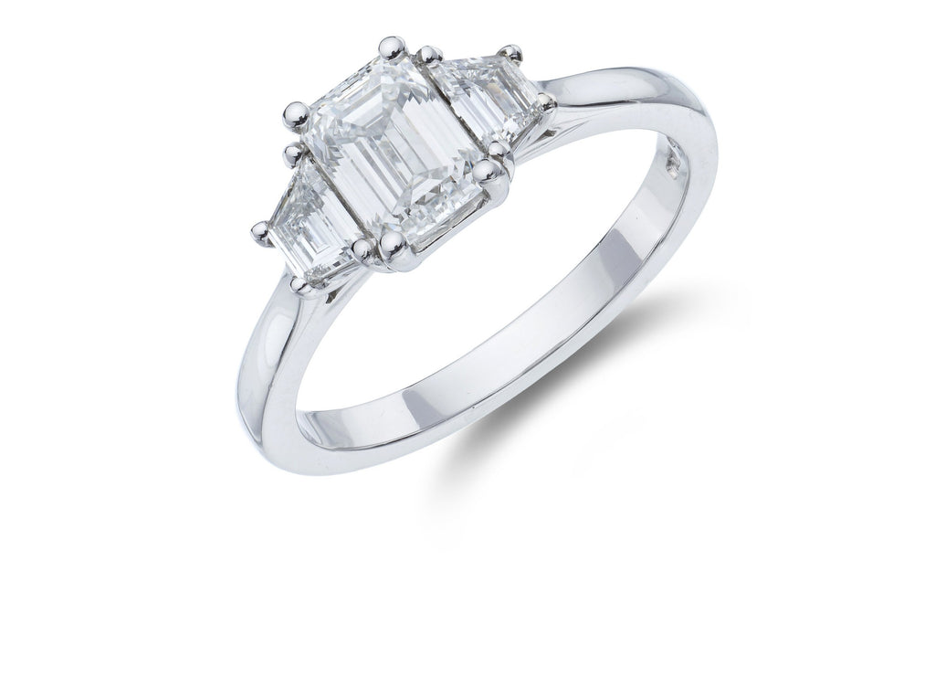 Platinum 3 stone Emerald Cut Diamond and Trapezoid Ring.