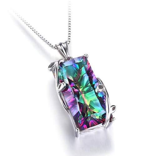 Mystic Rainbow Topaz 925 sterling silver laying down white background