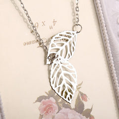 new leaf silver leaves necklace pendant laying on prop
