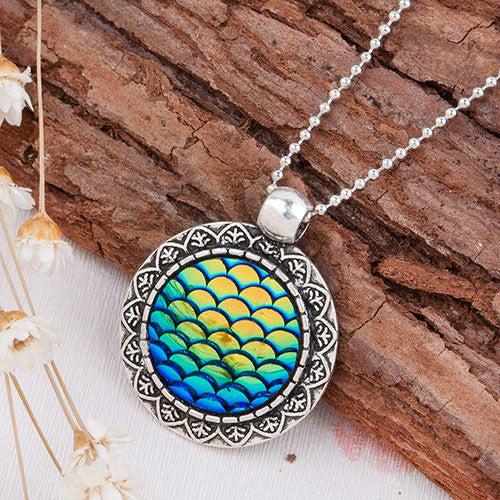 mermaid-pendant-fish scales-necklace green blue on wood