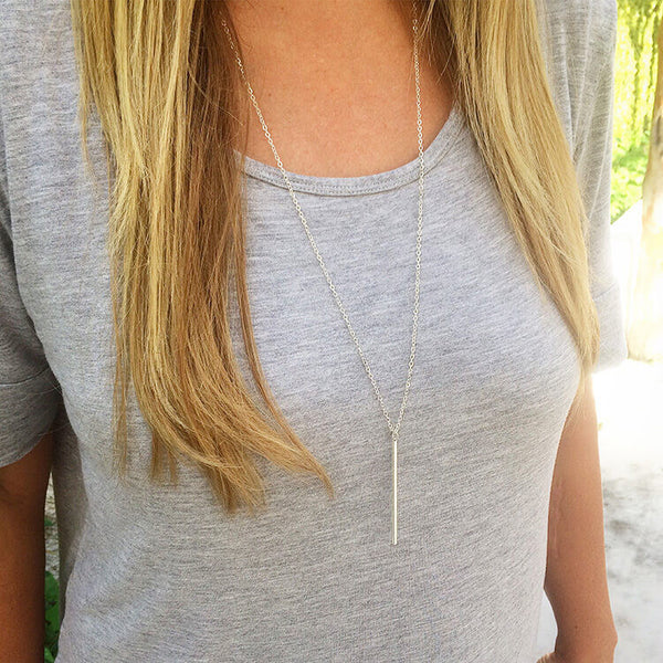 silver-charm-bar-necklace-jewelry-grey-shirt