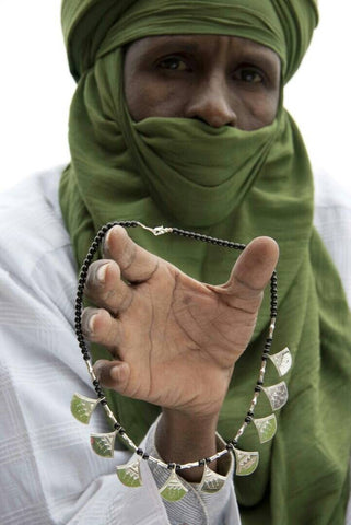 Mohammed holding Chat Chat Engagement Necklace Fine Sterling Tuareg Jewelry
