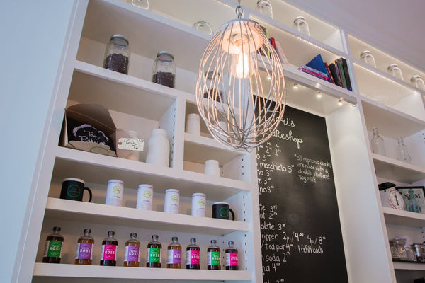 Large Whisk Pendant Lamps seen at Tori More Bakeshop, as featured on Apartment Therapy