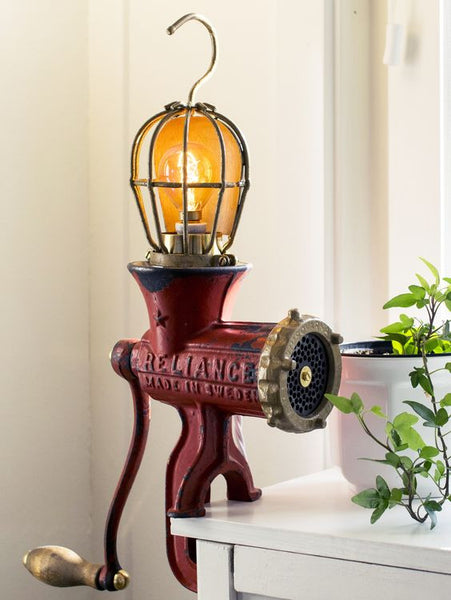 DIY Table lamp  made from a vintage red Husqvarna meat grinder and a vintage lamp cage.