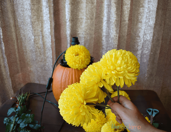 How to Upcycle an IKEA Lamp into a Floral Pumpkin Centerpiece Lamp - See the full DIY tutorial at www.ilikethatlamp.com