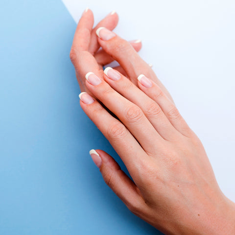 hands in blue background
