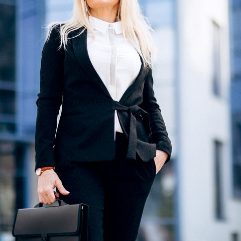middle-aged-business-woman-with-suitcase-by-bussiness-center