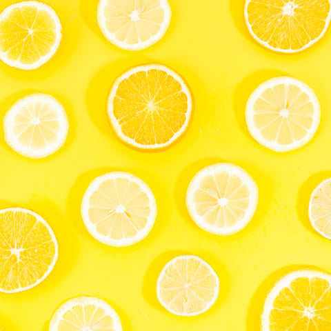 sliced-citrus-fruits-yellow-background