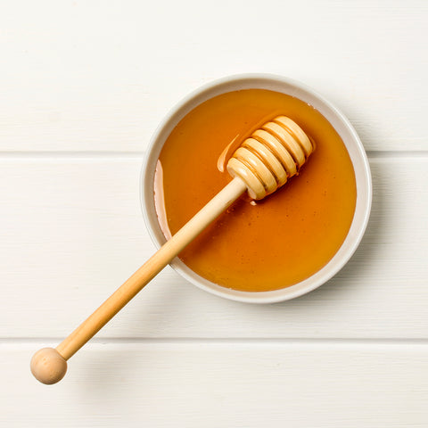 top-view-honey-bowl-with-spoon