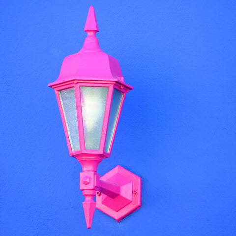 vertical-shot-pink-sconce-lamp-attached-blue-wall