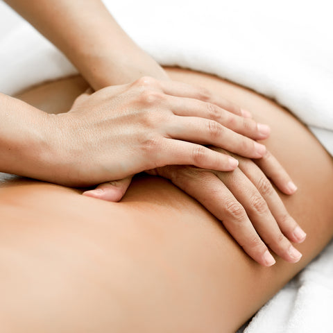 young-woman-receiving-back-massage-spa-center