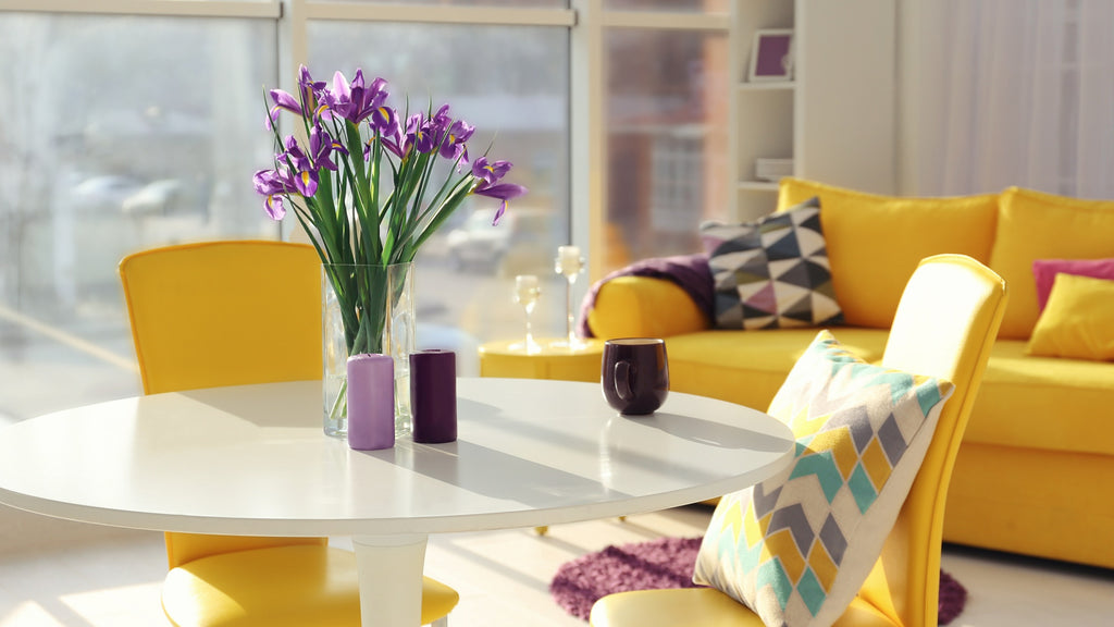Yellow accent colours on dining chairs and sofa