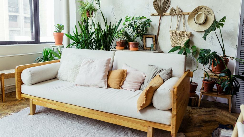 Sofa in living room inspired by biophilia trend