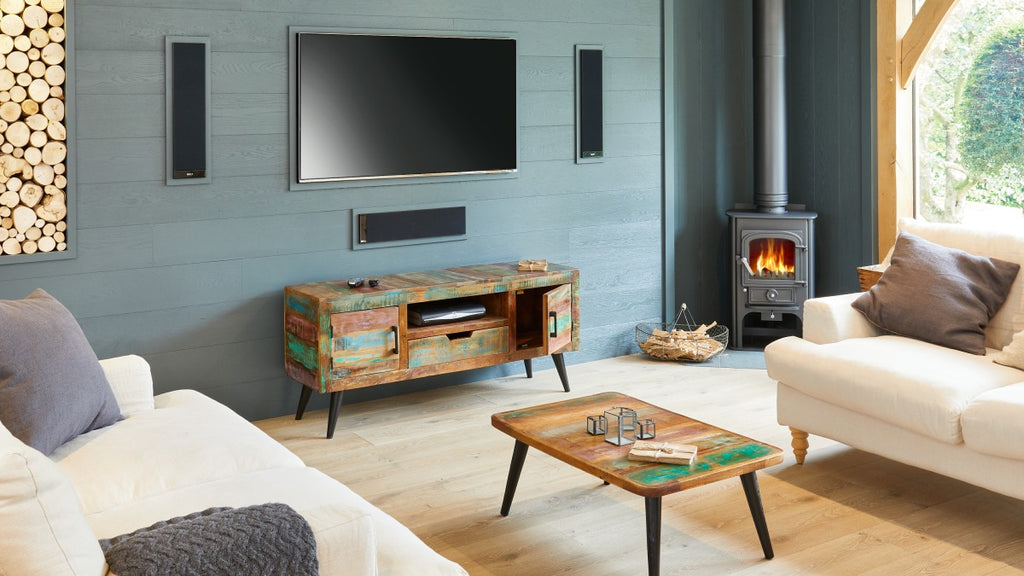 Coffee table and TV stand made from reclaimed wood, in cosy living room.