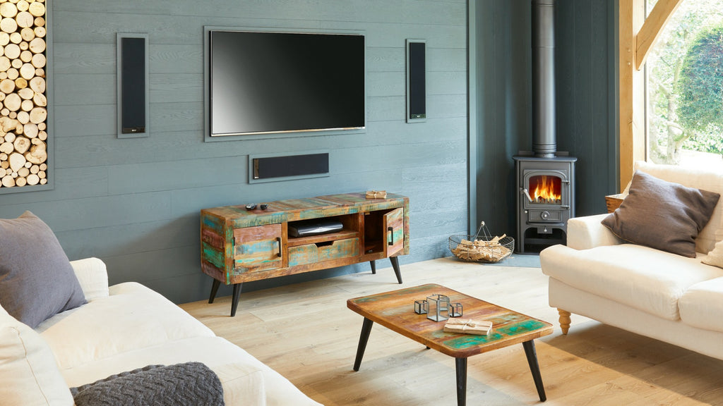 Modern sitting room with reclaimed wood TV stand and mounted television on wall